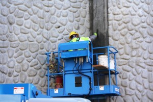 FTC workers put the finishing touches on a recently poured abutment wall at one of three Citrus Ave bridges underway in Azusa. 