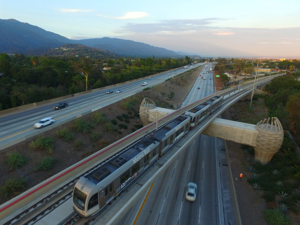 Passenger Transport caption: An aerial shot of a test train on Los Angeles Metro's Foothill Gold Line Extension arriving at the Arcadia Station. The line from Pasadena to Azusa opens March 5.