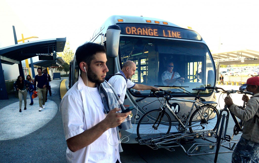 A Metro Orange Line bus lets passengers off at the Sepulveda Metro Orange Line Station on Nov. 5, 2015. (Photo by Dean Musgrove/Los Angeles Daily News)