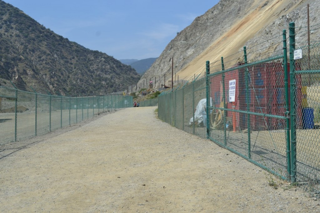 Don't be misled by the start of the Fish Canyon hike, which wends through mining infrastructure and facilities. Lush green landscape and water are reached after about a half-mile walk.