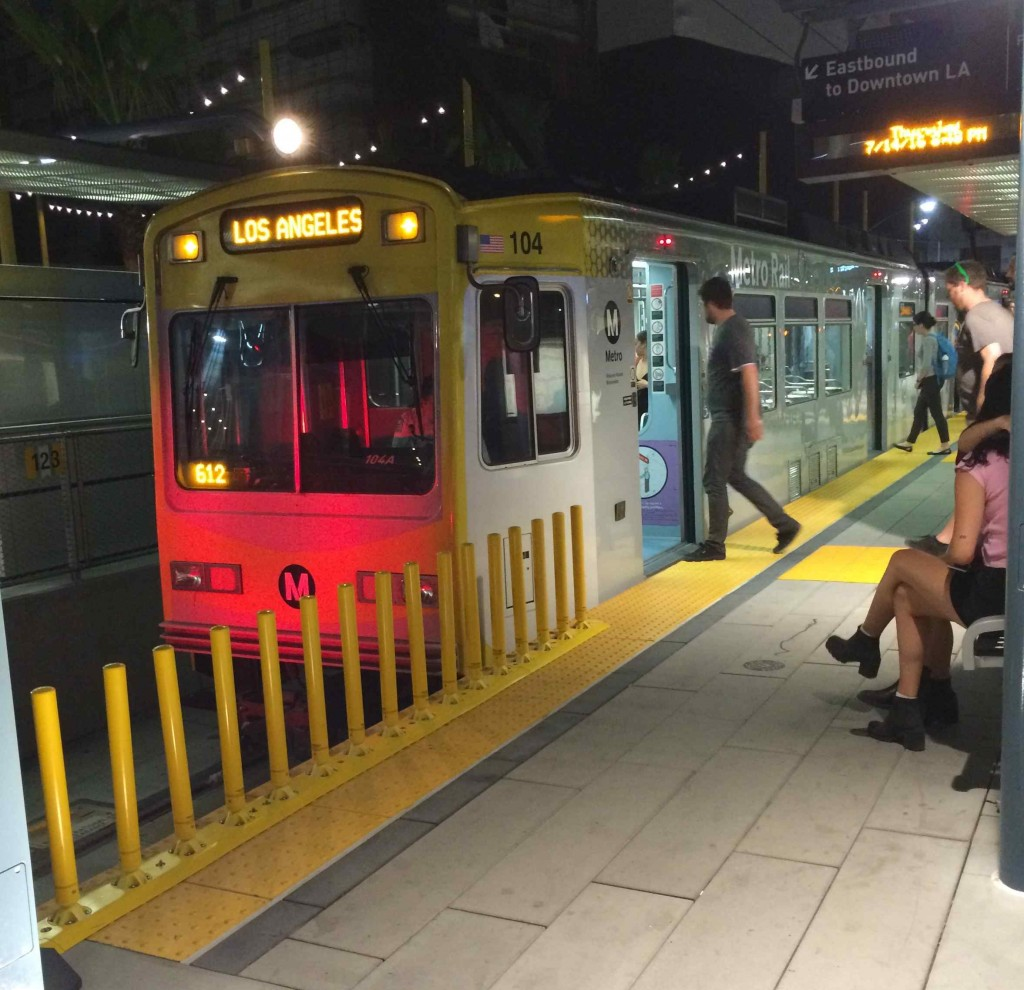 Passengers board the Expo Line in Santa Monica to head back to L.A. July 14. Our columnist rode from Azusa to Santa Monica and back, a journey only possible due to two recent light rail extensions. (Photo by David Allen)