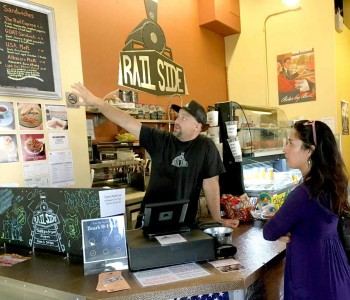 Railside Cafe owner Jordan Nachbaur takes an order from Glendora resident Anisa Hans. The Railside Cafe is part of the Grove Station mixed-used development in San Dimas, Calif., which was built in anticipation of the Gold Line station. Sept. 9, 2016. (Neil Nisperos/Inland Valley Daily Bulletin-SCNG)