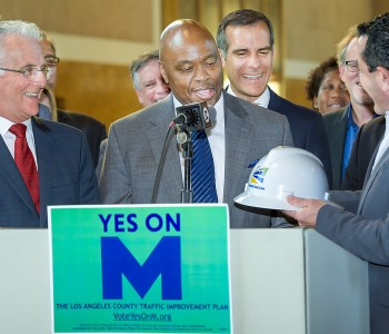 Paul Krekorian, Los Angeles councilmember, and Los Angeles Mayor Eric Garcetti watching Habib Balian, right, Foothill Gold Line Construction Authority CEO giving Phil Washington. CEO of Los Angeles County Metropolitan Transportation Authority a Hard Hat Safety Helmet, for work that needs to be accomplished now the Yes On M that voters passed. Los Angeles Metro press conferences was held at  Union Station Wednesday, November 9, 2016 in Los Angeles.  (Photo by Walt Mancini/Pasadena Star-News/SCNG)