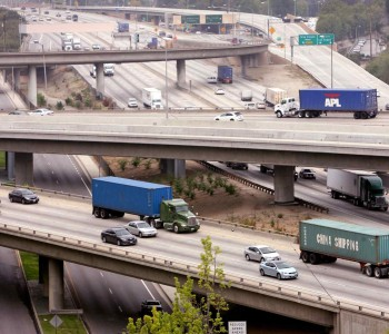 Car and truck traffic flows through the interchange of the 60 and 57 freeways in Diamond Bar. (File photo)