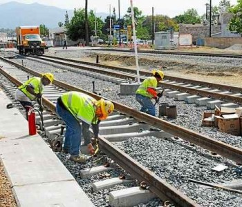 A 2014 file photo shows construction in Azusa on the Gold Line Extension, an example of Metro transit projects that bring both transportation benefits and jobs to the area. (Photo by Walt Mancini/Pasadena Star-News)