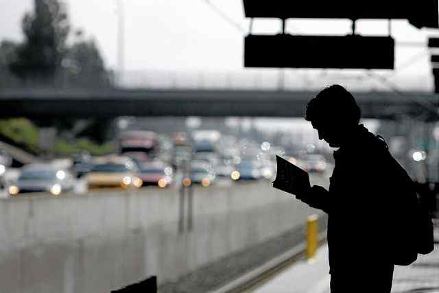 ***STAFF FILE PHOTO***Justin Beck, of Pasadena, reads while waiting for the westbound Metro Gold Line at Lake Station in Pasadena Tuesday morning, April 26, 2011. Metro officials say 3,000 more people per day rode the Gold Line this March as compared to March 2010, a 10 percent increase as gas prices topped $4 a gallon in Los Angeles County. (SGVN/Staff Photo by Sarah Reingewirtz/SXCITY)