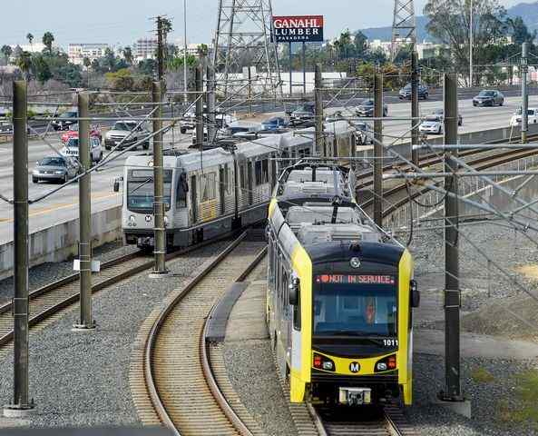 FILE PHOTO. The new Kinkisharyo, right, Metro Gold Line Foothill Extension, passing through all six new station stops in Arcadia, Duarte, Irwindale, Azusa. Azusa Pacific University/Citrus College Wednesday, February 17, 2016. Photo by Walt Mancini/Pasadena Star-News-SCNG