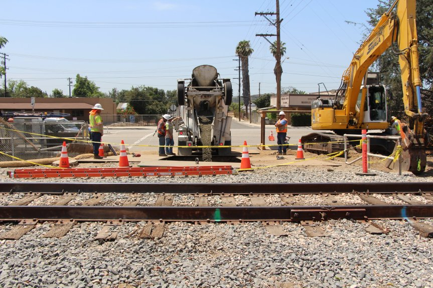 Construction crews from the utility-relocation work for the Gold Line Glendora-to-Montclair extension, backfilling newly-protected sewer line at B Street in La Verne. July 12, 2018. (photo courtesy of the Metro Gold Line Foothill Extension Construction Authority).