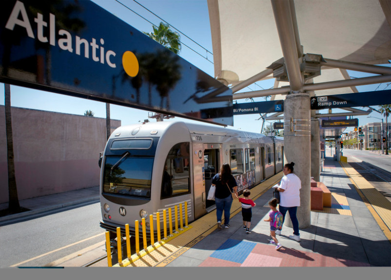 Train patrons embark the East Side Gold Line at its terminus at  Atlantic and Pomona boulevards in East Los Angeles March 16, 2016.  (Photo by Leo Jarzomb/San Gabriel Valley Tribune)