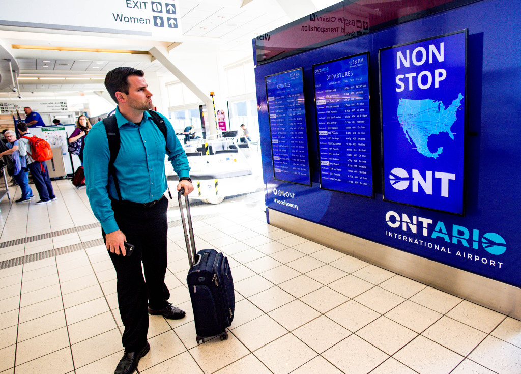 A man checks the flights status on a screen at Ontario International Airport in Ontario on Monday, Nov. 4, 2019. (Photo by Watchara Phomicinda, The Press-Enterprise/SCNG)
